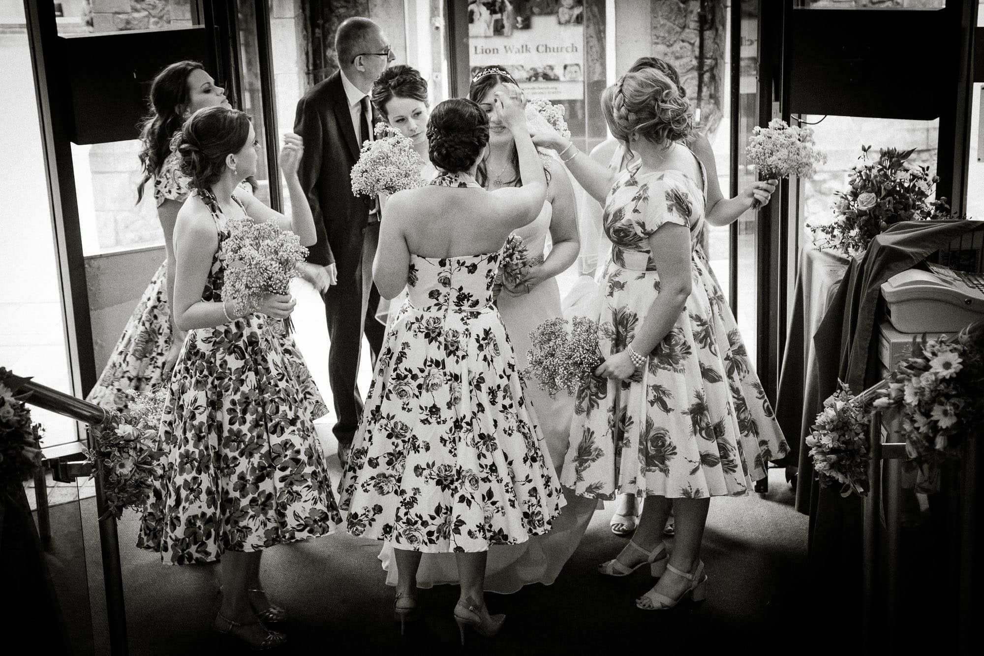 Bride and bridesmaids last minute adjustments, Red Lion Church, Colchester ,Essex.