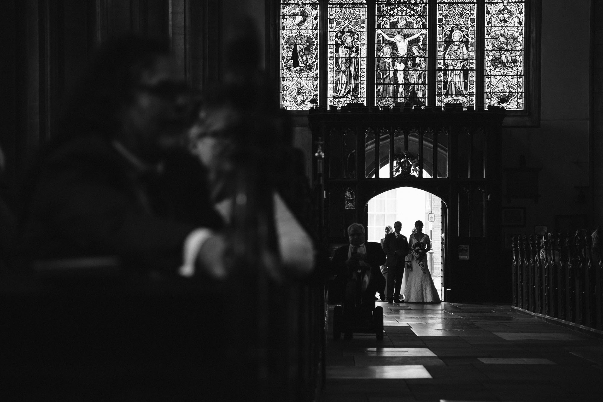 Bride and father entering church photograph, St Mary\'s Church Bury St Edmunds