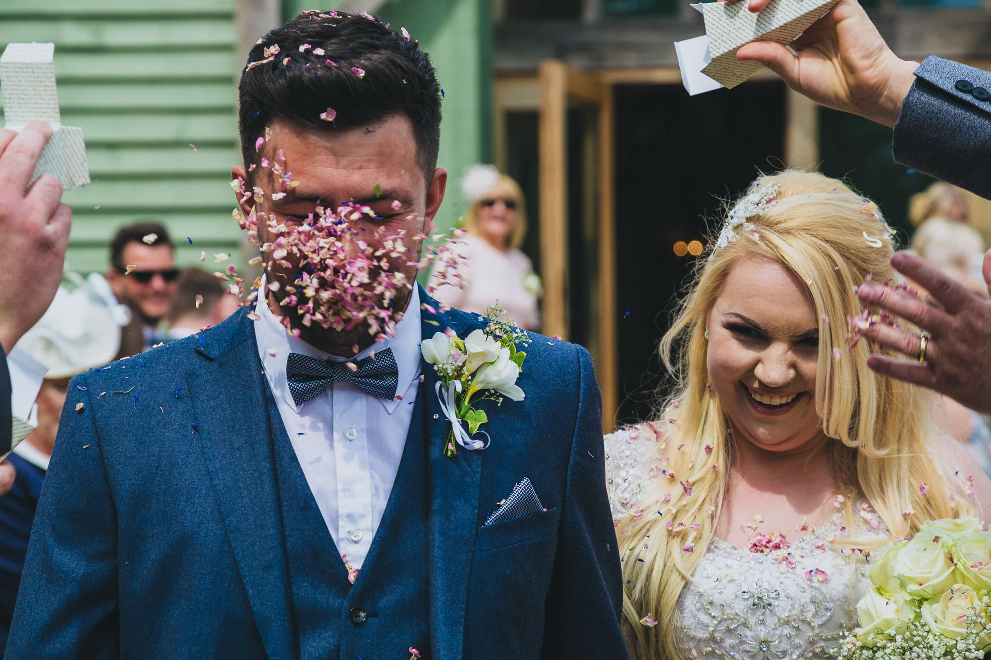 Bride and groom confetti in face photograph