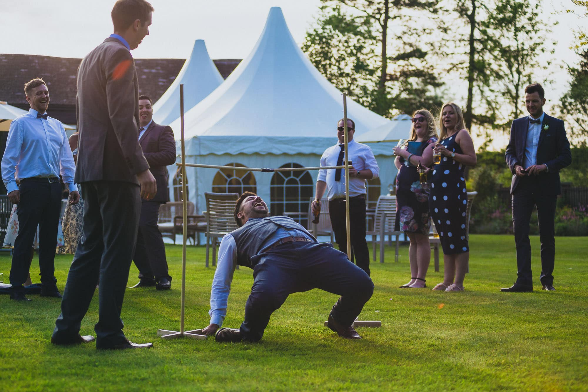 Wedding reception games wedding photography, groom limbo